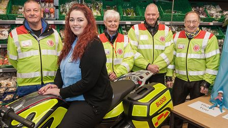 The Co-Operative, Earlham Road, Norwich staff member Laura Howard with members of Serve Norfolk ( l