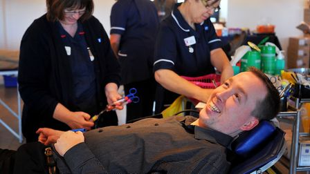 First time blood donor Peter Raven being prepared at a session at Carrow Road. Photo: Bill Smith