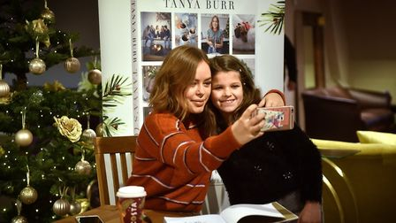 Tanya Burr book signing at Jarrolds. A young fan gets a selfie. Picture: ANTONY KELLY