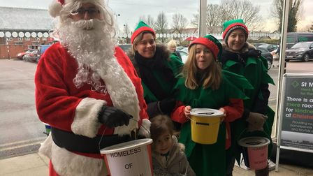 Members of the Attleborough 2000 Trust joined by Santa, collecting in aid of St Martins HousingTtrus