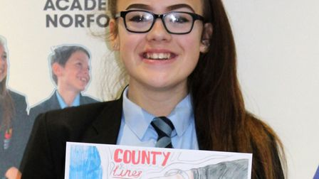 Wayland Academy pupil Megan Wells and her competition-winning poster. Picture: TEN Group