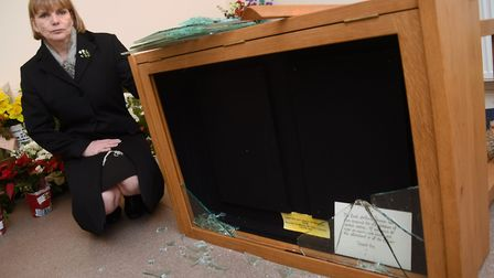 Karen Walford, crematorium manager, with the smashed cabinet which housed one of the two Remembrance