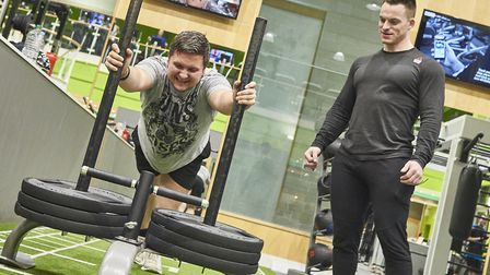 Daniel Butcher being put through his paces by personal trainer Matt Deller. Picture: JAMIE GARBUTT