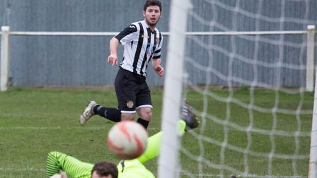 Swaffham Town's Alex Vincent watches his effort goes in off the post against Framlingham. Picture: E
