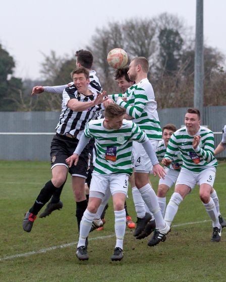Swaffham Town's Danny Tindall puts himself about in a crowded penalty area. Picture: Eddie Deane