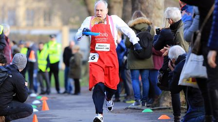 Alastair Stewart OBE, ITV News pictured taking part in the Rehab Parliamentary Pancake Race 2017. Pi