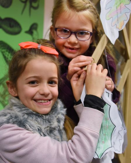 The caring for wildlife in winter weekend at Norwich Castle. Lexie Heather, eight, front, and Poppy