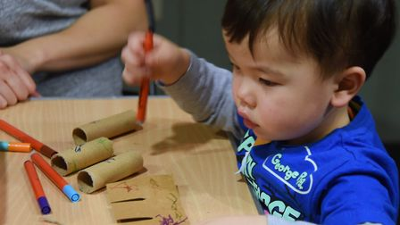 The caring for wildlife in winter weekend at Norwich Castle. Fraser Lund, two, does some colouring.