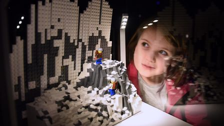 Five-year-old Violet Moore Fuller studies the Matterhorn, made from 2500 lego bricks, at the Brick W