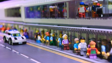 Passengers at the front of the lego airport display, at the Brick Wonders exhibition at the Forum. P