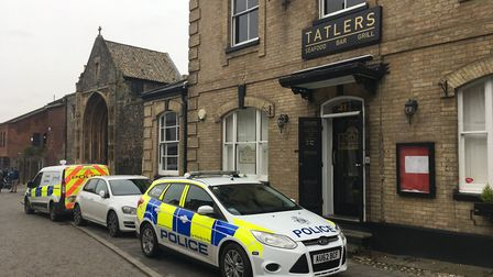Police vehicles outside Tatlers in Tombland, Norwich. Picture: ANDREW STONE