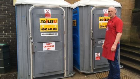Kingston Gray, owner of Lucy's Chips, with the replacement portable toilets. Picture: Jacob Massey