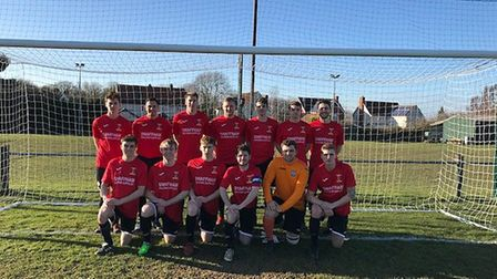 Swaffham Town line up for a team picture in their away kit. Picture: Gerry Palmer