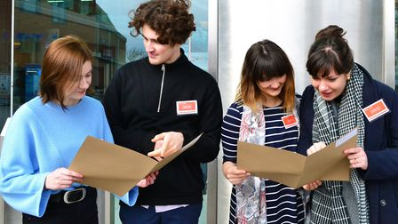 Intrepid sleuths study last years casefile in Norwich city centre, (left to right) Eve Mahoney, Will