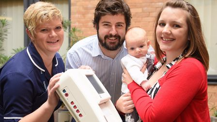 Tom and Laura Burdett, with their son Leo, at the Norfolk and Norwich University Hospital with the f