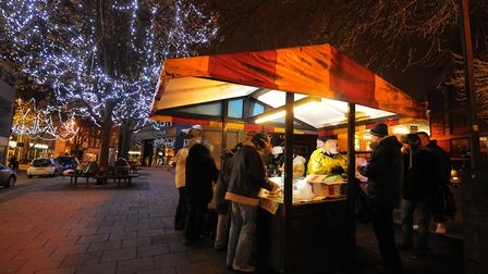 Giving warm food to homeless people in Norwich from the smaller stall at the front of Hay Hill. PHOT