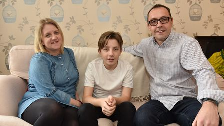 Archie Ramshaw with his mum Theresa and dad Craig. The family are raising money to help fund them du