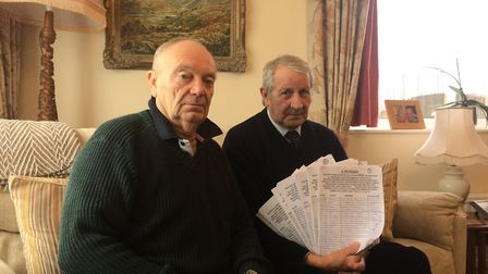 Norman Phillips and Bryan Wykes with the petition against Watton Town Council's decision to seek to