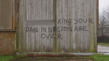Graffiti on barn door at Necton Farm. Picture: Colin King