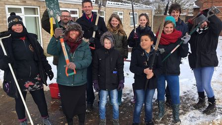 Volunteers help clear the snow at Melbourne Cottages, Norwich