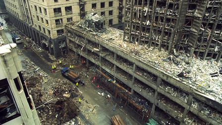The devastation of the Hong Kong and Shanghai Bank and the crater left in Bishopsgate [left, foregr