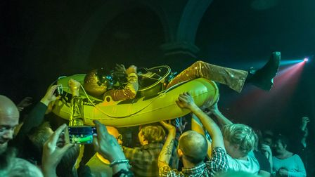 Bob Log III crowdsurfing in a boat at Norwich Arts Centre, 22nd March 2018. Photo: Paul Jones