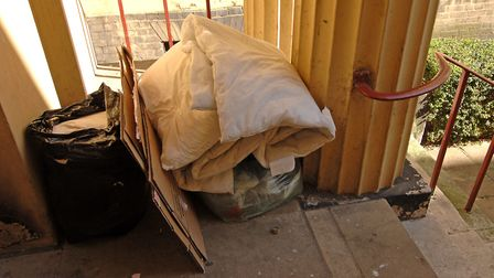 Bedding stashed by homeless people sleeping rough outside the Advice Arcade in Norwich, opposite Cal