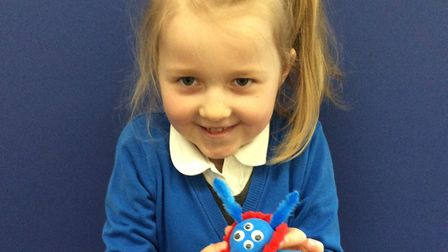 Watton Westfield Infant and Nursery school pupil Julia Wardzala with an alien she created after the