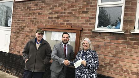 Persimmon Homes Anglia sales manager Jorden Knell (centre) with Brian Wright and Rev Linda Turner of