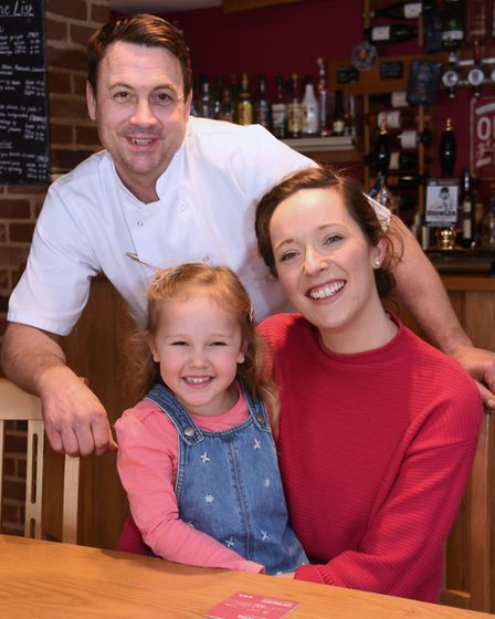 Daniel and Jenny Leeder, who have taken over the King's Head at New Buckenham, with their daughter,