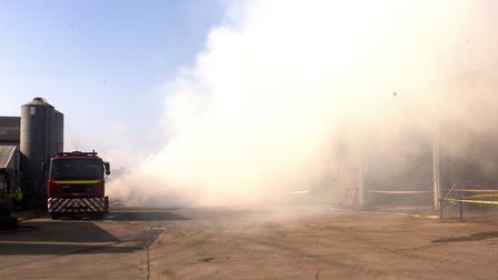 A blaze broke out in a large agricultural building at Peddars Pig Farm in Spooner Row in the early h