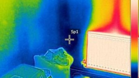 Thermal imaging survey at Justin and Tracy Revell's home showing heat escaping through the walls (in