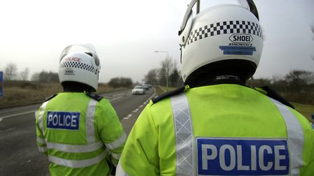 Police officers carry out ANPR (automatic number plate recognition) checks. Picture: Archant library