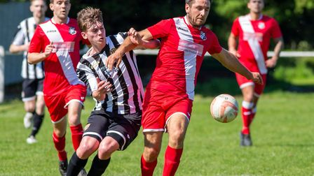 Swaffham Town's Tommy Hunt trying to muscle in on a hot afternoon at Shoemakers Lane. Picture: EDDIE