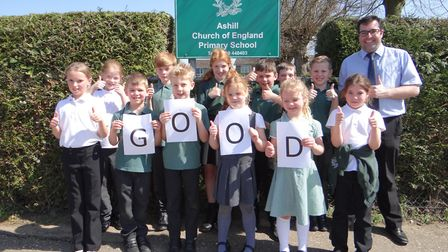 Ashill Primary School pupils and headteacher Steve Creasey celebrate their good rating from Ofsted f