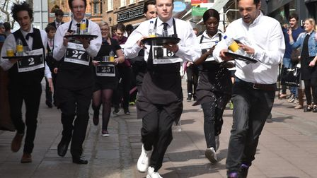 Waiters from across Norwich take part last year's Waiter's Day Race. Photo: Sonya Duncan