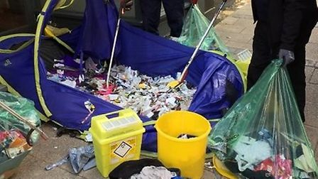 Workers removed piles of syringes from the tent on Brigg Street, Norwich