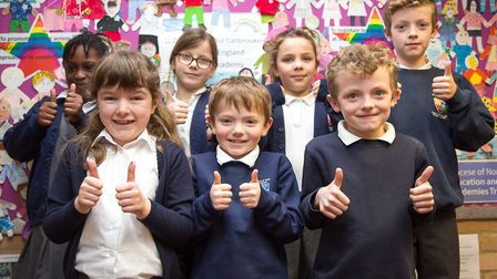 St Peter and St Paul Carbrooke Primary Academy pupils celebrate the schools good Ofsted rating. Pict