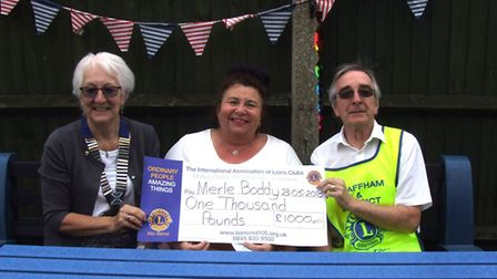 Swaffham Lions handed over a cheque of £1,000 to The Merle Boddy Centre. Picture: Swaffham Lions