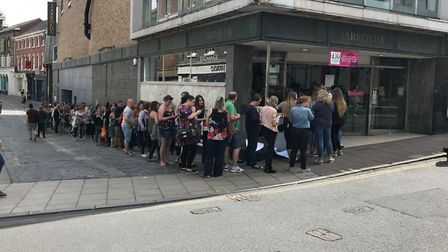Fans queue in Norwich for Giovanna and Tom Fletcher book signing. Picture Geraldine Scott.