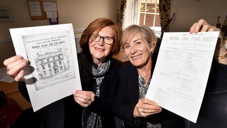 Mary Chacksfield, left, and Bernie Sheehan from Norwich Credit Union with copies of old Norwich Muta