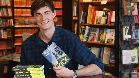 Waterstones book seller Mitch Johnson with his first novel, Kick. Picture: DENISE BRADLEY