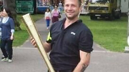 John Worthington holding the Olympic torch in 2012. Picture: Samantha Harrowven