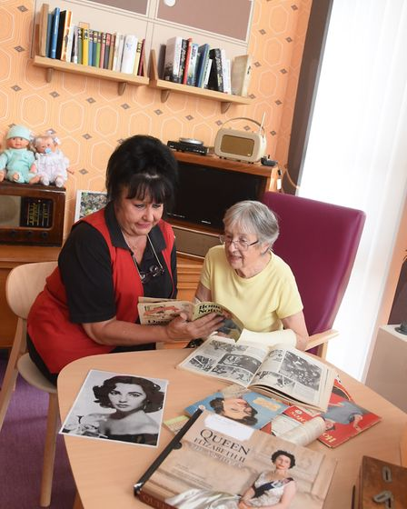 Patient Rita Mallett, right, chats with volunteer Pat Garrod over knitting patterns in the new 1950s