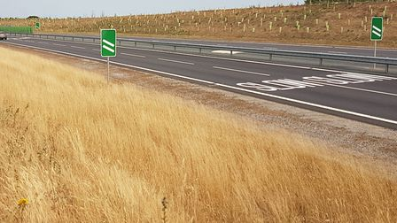 The new countdown marker signs and the SLOW markings at the airport north roundabout on Broadland No