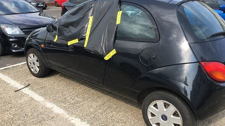 Eight vehicles - including an Audi RS4 and a BMW - have been broken into at a Norwich car park. Phot