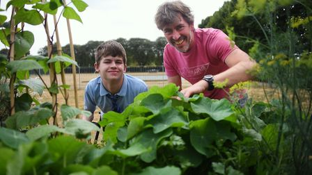 Clare School pupil Thomas, with Rob Howe from Eaton Park Café, take a closer look at one of the two