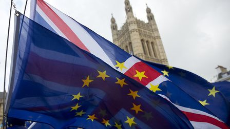 Union and EU flags fly outside Houses of Parliament. PHOTO: EMPICS Entertainment