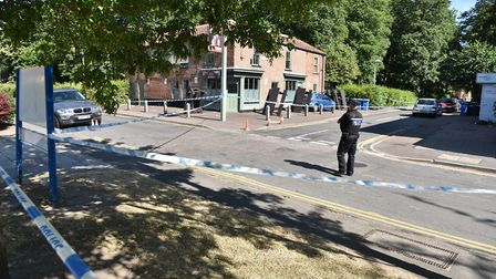The police cordon around woodland on Adelaide Street in Norwich and surrounding roads after a shooti