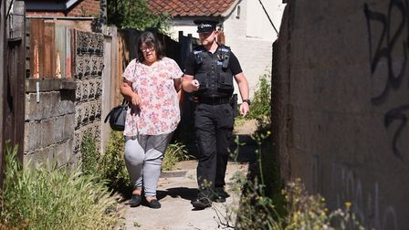 District and county councillor, Julie Brociek-Coulton, walks along an alleyway off Silver Street wit